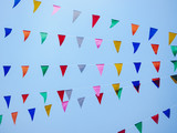 Festival outdoor colourful flag decoration with blue sky background - 221955856