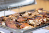 Close up photo of roasted pork meat served on a buffet tray - 221957417