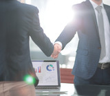 handshake of a businessman and investor in the office - 221960220