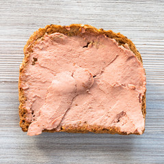 bread sandwich with pate on gray wooden table