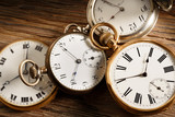 vintage pocket watches on aged wood