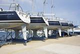 Luxury yachts at shipyard waiting for maintenance and repair - 221965242