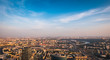 Aerial top view of Moscow city panorama at sunset, river and bridges, roads and buildings in evening myst
