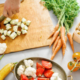 Man hands cuts vegetables cooking vegetable stew - 221970267
