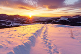 Winter sunrise in the hills mountains.