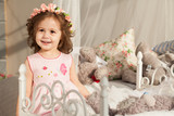 Little cheerful girl with toys - 221986488
