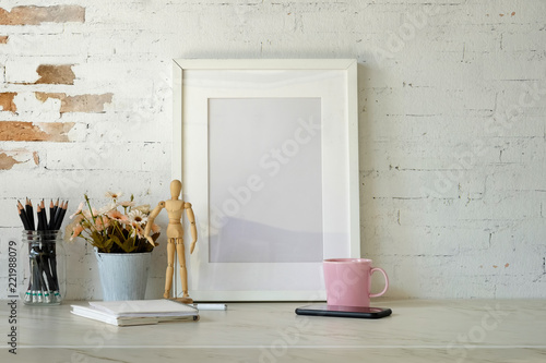 Fototapeta Mockup poster with home office supplies on white desk.