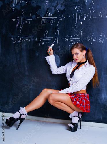 Leinwandbild Motiv  attractive striptease dancer dressed as a schoolgirl