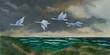 canvas print picture - Vier Zugvögel fliegen an der Küste über dem Meer