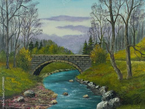 Leinwanddruck Bild Alte Steinbrücke über einem kleinen Flußlauf