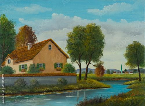 Leinwanddruck Bild Haus am Fluß in der nähe von einem kleinen Ort