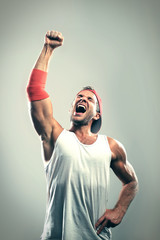 Athlete with a raised hand celebrates victory © Zarya Maxim