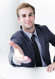 Smiling businessman giving hand for handshake - 221998643