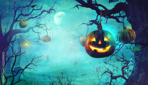 Halloween theme with pumpkins and dark forest. Spooky Halloween - 222000623