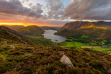 Moody dramatic clouds over high up view of Crummock Water at sunset. Lake District, UK. - 222007012