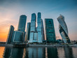 Panorama of Moscow City - new modern International business center with futuristic architecture skyscrapers buildings reflected in Moscow river at sunset