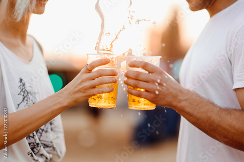 Fototapeta Couple cheering with beer. Close up