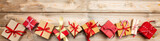 Fototapety Christmas gift boxes on wooden background, banner, copy space, top view