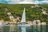 white yacht at sea with mountains and small town on background - 222016413