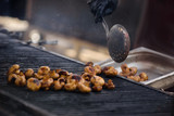 Closeup photo of fresh mushrooms cooking outdoor on grill