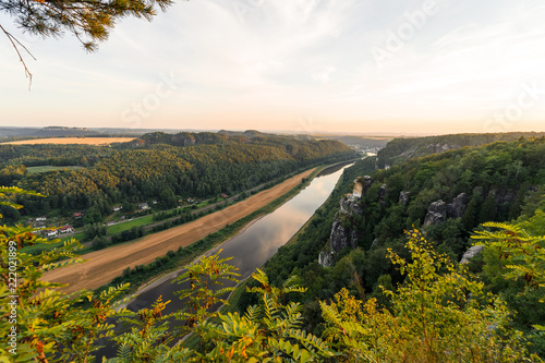 Foto Murales Landscapes of Saxon Switzerland - is the German part of Elbe Sandstone Mountains. Sunset over the valley of the river Elbe.