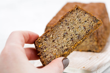 piece of homemade bread with quinoa, closeup