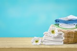 Laundry Basket with colorful towels on background - 222027608