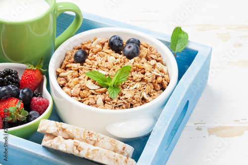 Healthy breakfast set with muesli, berries and milk