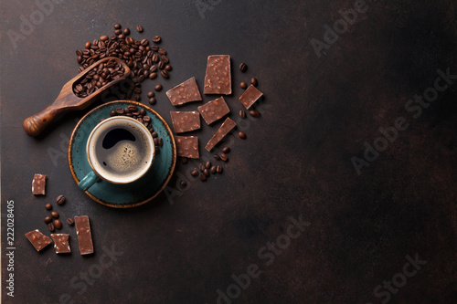 Coffee cup and chocolate on old kitchen table - 222028405