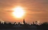 Colorful winter sunrise over village - 222029855
