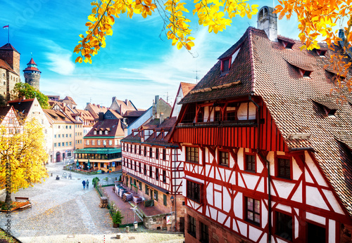 Leinwanddruck Bild Old town of Nuremberg at sunny fall day, Germany at fall, retro toned