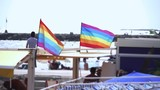 Slow motion gay pride flag blowing in the wind on Sitges, in Barcelona province. Perhaps Spain top gay destination, with LGTB events like Gay carnival, pride and Gay Spring break. Slowmotion from 120 - 222032804