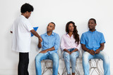 African american nurse with patients at waiting room - 222035863