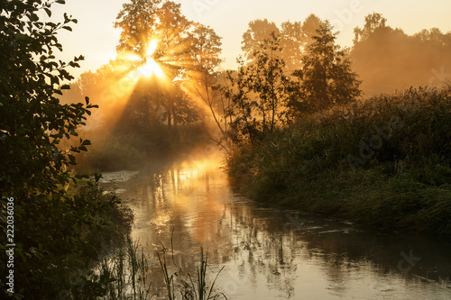 Fog over the river with the rising sun. © finist_4