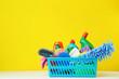 Leinwandbild Motiv Bottles with detergent and cleaning tools on yellow background