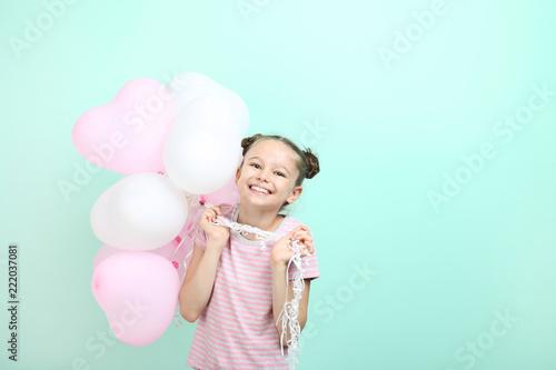 Leinwanddruck Bild Beautiful young girl with balloons on mint background