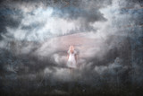 Woman in white dress walking on countryside meadow. Artistic grunge textured background.