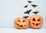 Halloween craft background with pumpkins and flying bats. - 222049838