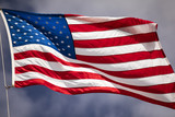 Flag of the USA flies in the wind - 222054052