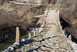 Landscape of Ancient Bridge of Missios in Vikos gorge and Pindus Mountains, Zagori, Epirus, Greece