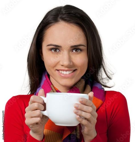 Young woman holding a large coffee mug - 222066411