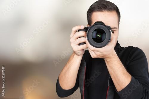 fototapeta na ścianę Closeup of a Photographer Taking Photos