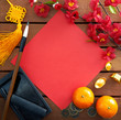Chinese new year decorations with a blank red paper as copy space