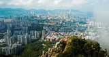 Man taking photo of Hong Kong cityscape from the Lion rock aerial view - 222093098