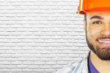 Portrait of young mixed race man construction worker - 222094675
