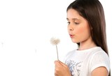 Young girl holding a dandelion blowball