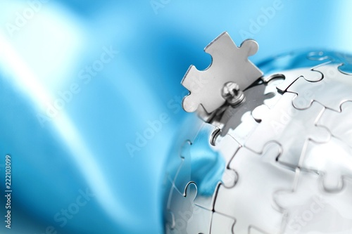 Globe made out of puzzle pieces - global business/global