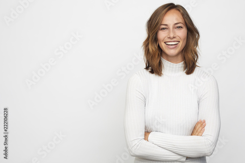 portrait of young happy woman looks in camera