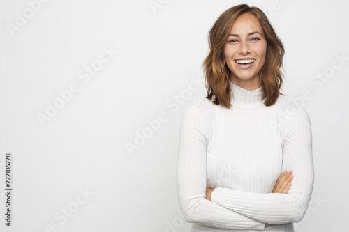 Leinwandbild Motiv portrait of young happy woman looks in camera