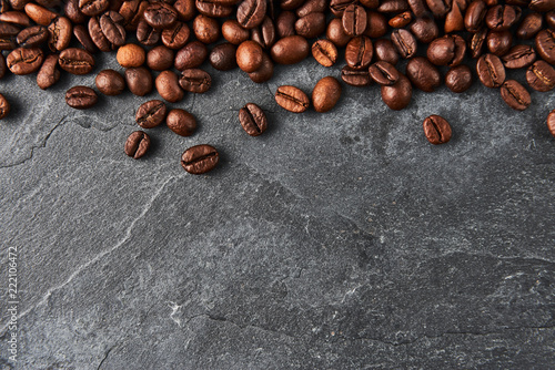 Coffee beans on dark stone table. Top view with copy space. - 222106472